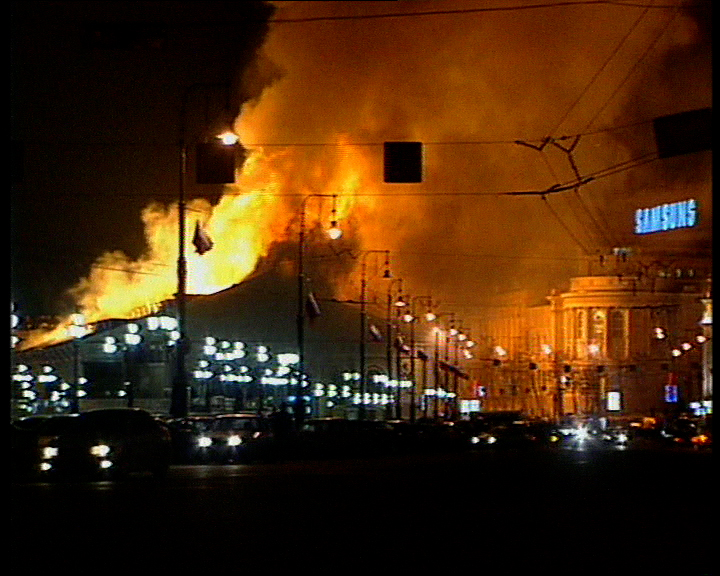 Flames of burning Manezh exhibition center near Moscow's Kremlin. Fire, Moscow architecture